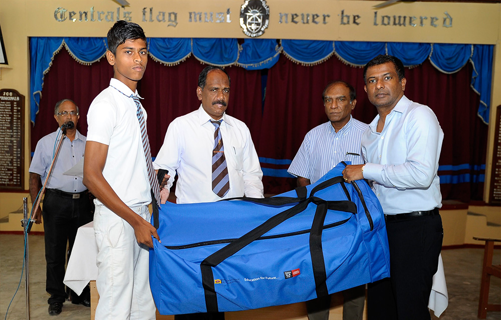 Jaffna Central College principal and cricket captain accepting the cricket gear from Mr. Victor Rajeevan, CEO of NCHS and Mr. Jaya Rudra, Director of NCHS.